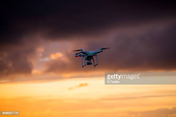 Flying drone in clouds sky