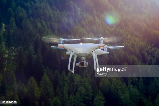 Flying drone with camera. Alternative names for drones are quadcopter, uav or multicopter.