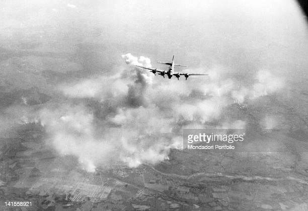 Flying Fortress flying over the fires of the oil refineries of the Polish town Oswiecim Oswiecim 20th August 1944