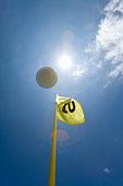 Flying Golf Ball in Blue Sky, Lens Flare