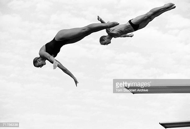 Flying High Divers take off from springboards at the Fort Lauderdale Aquatic Complex in Florida