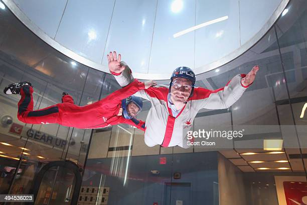 Flying instructor Derek Vanboeschoter teaches a guest how to fly in a wind tunnel at the iFly indoor skydiving facility on May 29 2014 in Rosemont...