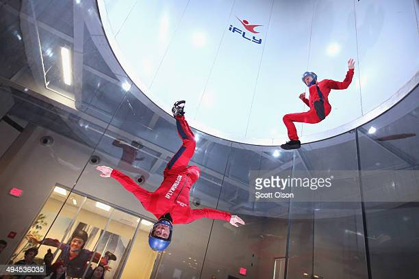 Flying instructors Derek Vanboeschoter and David Schnaible demonstrate wind tunnel flying at the iFly indoor skydiving facility on May 29 2014 in...