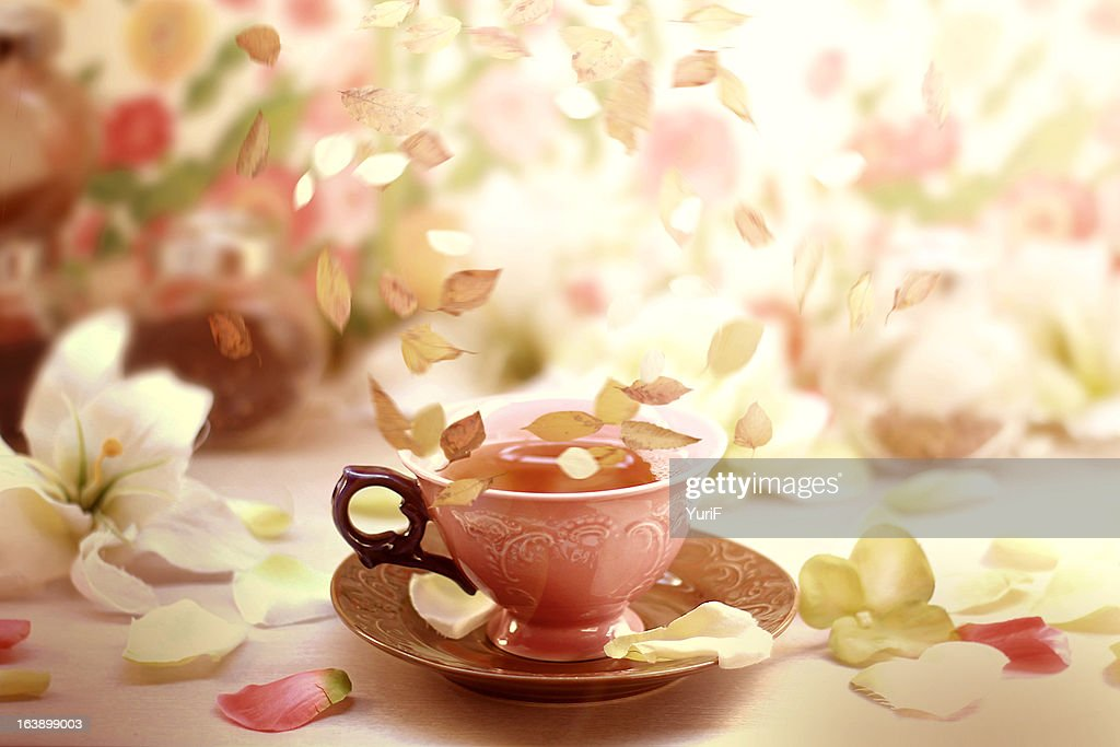 Flying leaves on a cup of tea. : Stock Photo