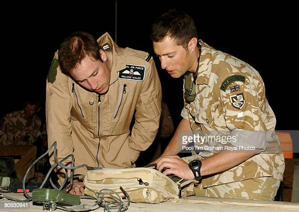 Flying Officer William Wales Prince William receives a briefing from Flight Lieutenant Adam Freedman about the downlink receiver used to give real...