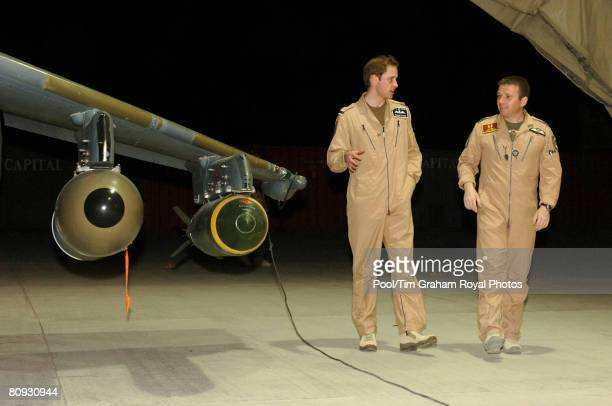 Flying Officer William Wales Prince William receives a briefing on the Harrier GR7A from Wing Commander Andy Lewis during a visit to Kandahar...