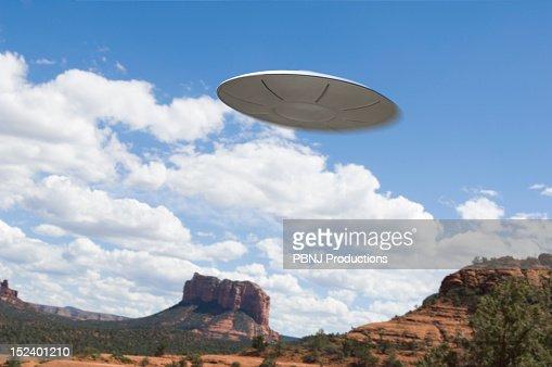 UFO flying over desert