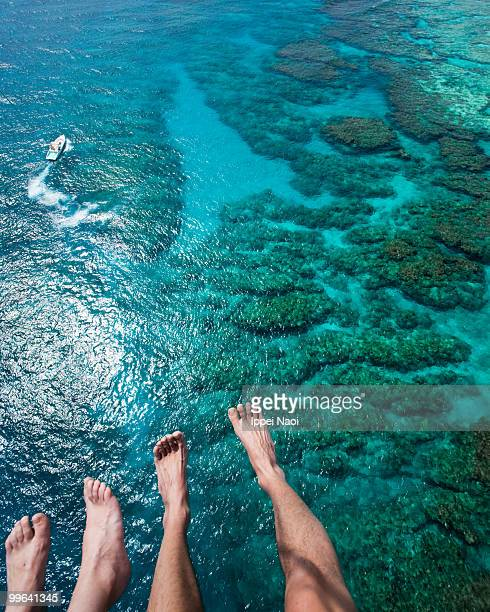 Flying over the coral reef and blue clear water