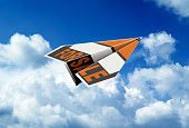 Flying paper plane with the words for sale against cloudy sky