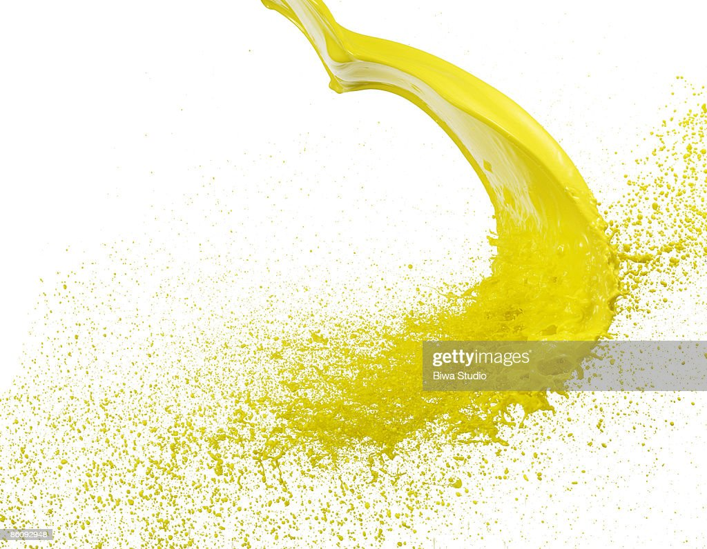 Flying spray of yellow water : Stock Photo