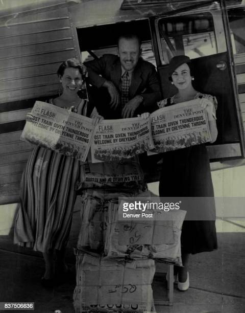 Flying The Denver Post on a fast Monday hop to Cheyenne Walbridge general traffic manager for the United States Airways Inc He is shown here with two...