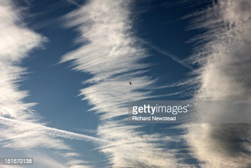 Flying through clouds : Stock Photo