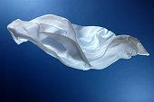 Flying white silk