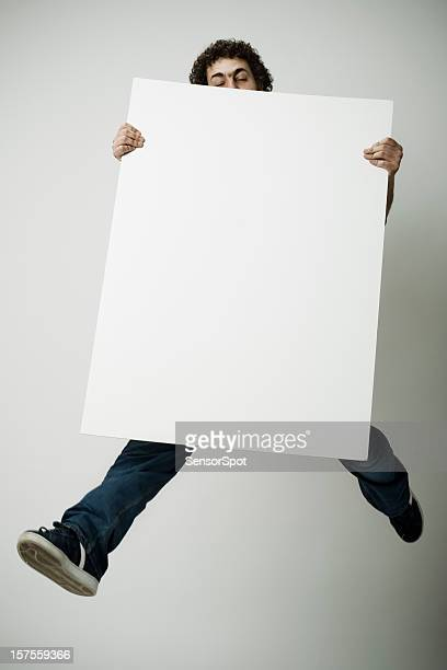 Flying with blank poster