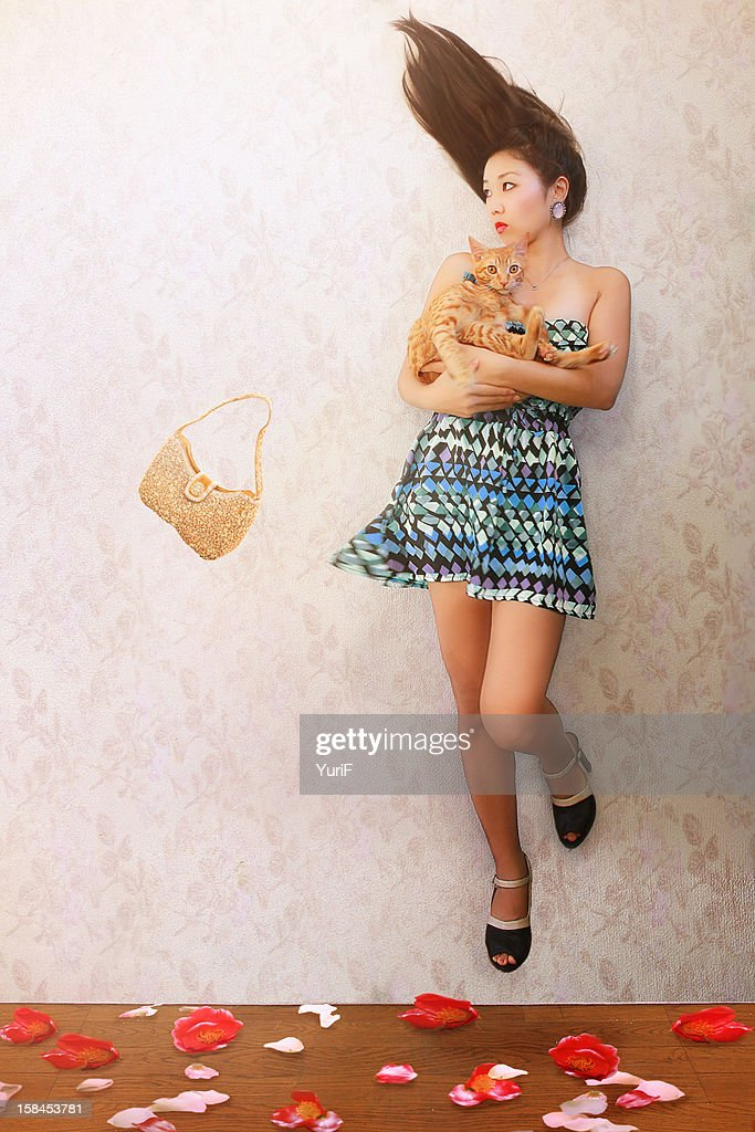 Flying woman and cat. : Stock Photo