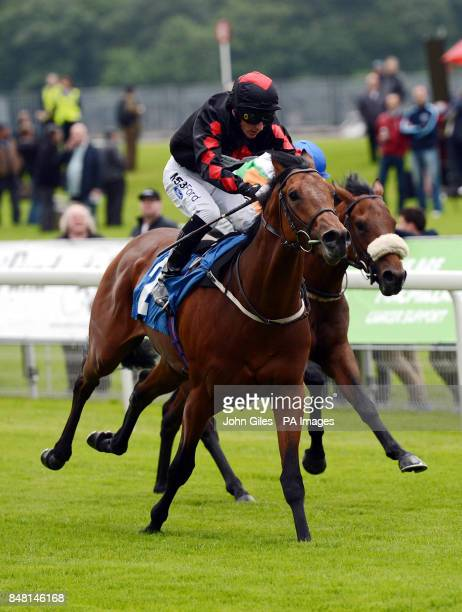 Flyman riden by Paul Hanagan win the Acturis EBF Maiden Stakes on Mid Summer Raceday during the June Meeting at York Racecourse York