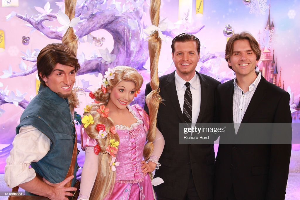 Flynn and Raiponce pose with directors Nathan Greno and Byron Howard as they attend the Raiponce Premiere during the Christmas Season Launch at...