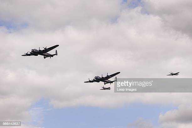 A flyover by the only two airworthy Avro Lancaster Bombers left from WW2 escorted by two Spitfires at the 6th Annual Combined Ops Show