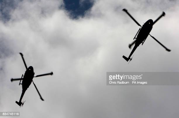 A Flypast by two RAF Lynx helicopters during the funeral of Corporal Jason Barnes at St Peters Church Colchester Essex