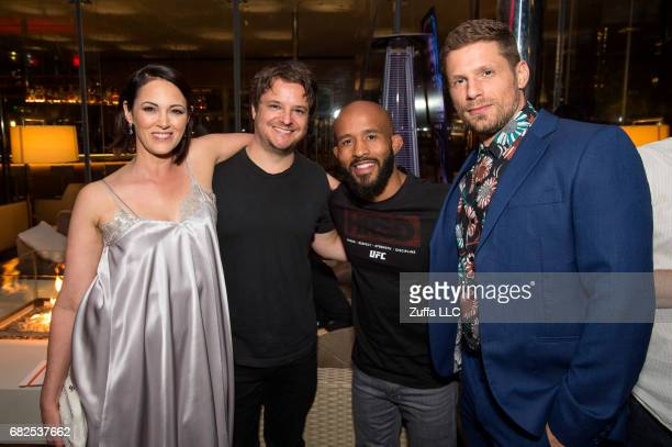 UFC flyweight champion Demetrious Johnson poses for a photo with Kingdom stars Joanna Going Byron Balasco and Matt Lauria during the UFC 211 Kingdom...