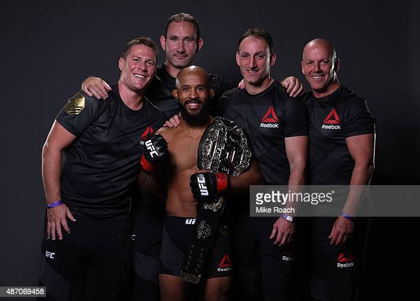 UFC flyweight champion Demetrious Johnson poses for a portrait with his team backstage during the UFC 191 event inside MGM Grand Garden Arena on...