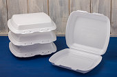 Foam for food is placed on wooden boards. Disposable food box