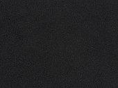 Foam rubber texture. Black sponge background. Dark polystyrene