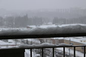 some focus on snow on balcony railing