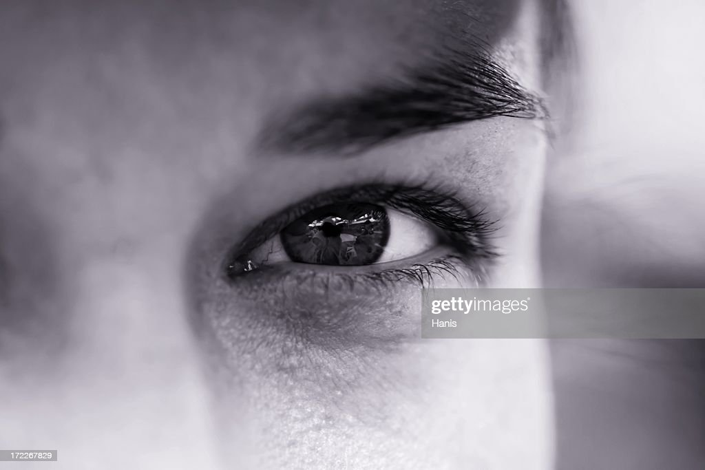 A focus shot of an eye of a man in black and white  : Stock Photo