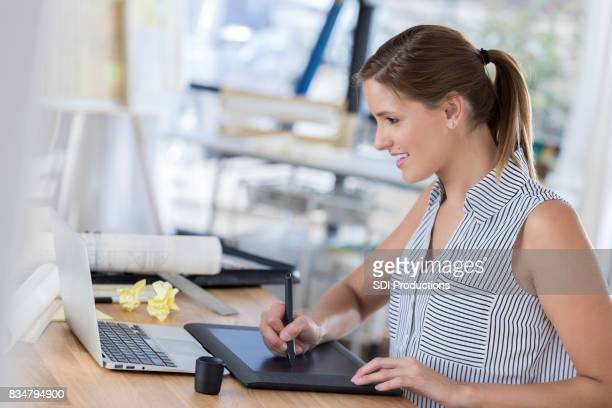 Focused architect uses graphics tablet