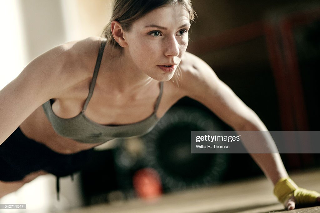 focused female boxer doing pushups stock photo getty images. Black Bedroom Furniture Sets. Home Design Ideas