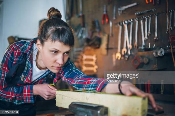 Focused Female Carpenter