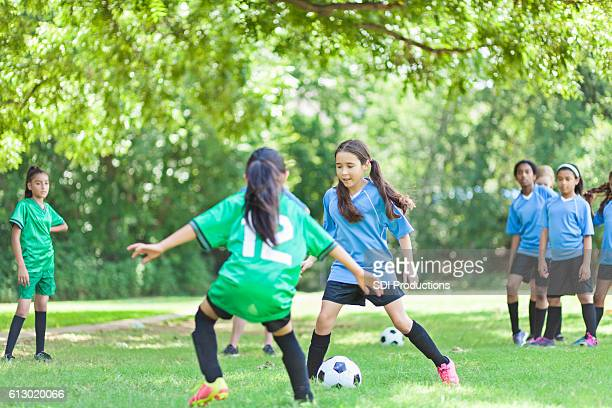Focused female  soccer players face off