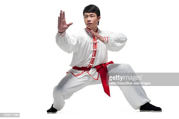 Focused Man Doing Martial Arts in Chinese Clothing