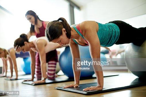 Focused on her pilates technique