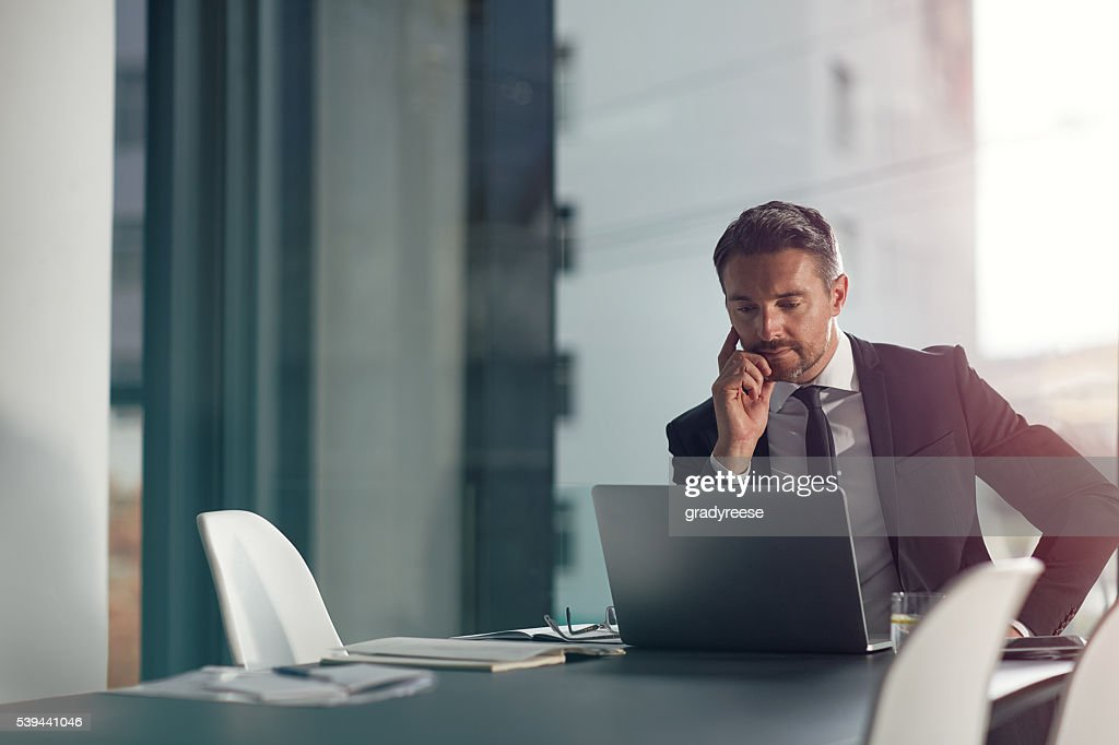 Focused on meeting his deadline : Stockfoto