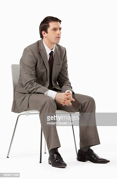 Focussed business man seated