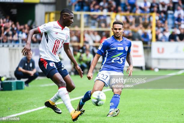 Fode Ballo of Lille and Kenny Lala of Strasbourg during the Ligue 1 match between Racing Club Strasbourg and Lille OSC at Stade de la Meinau on...