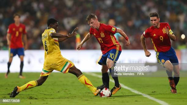 Fode Konate of Mali battles for the ball with Sergio Gomez and Abel Ruiz of Spain during the FIFA U17 World Cup India 2017 Semi Final match between...