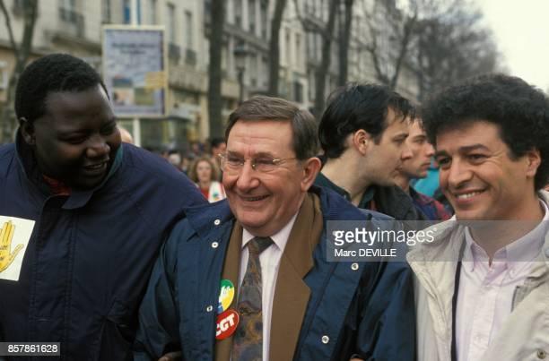 Fode Sylla president de SOS Racisme Louis Viannet Secretaire general de la CGT et Mouloud Aounit a la manifestation contre le CIP le 12 mars 1994 a...