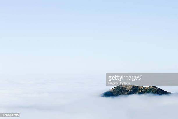 Fog blankets the southern hills on February 20 2014 in Wellington New Zealand The thick fog closed Wellington Airport affecting travel plans for...