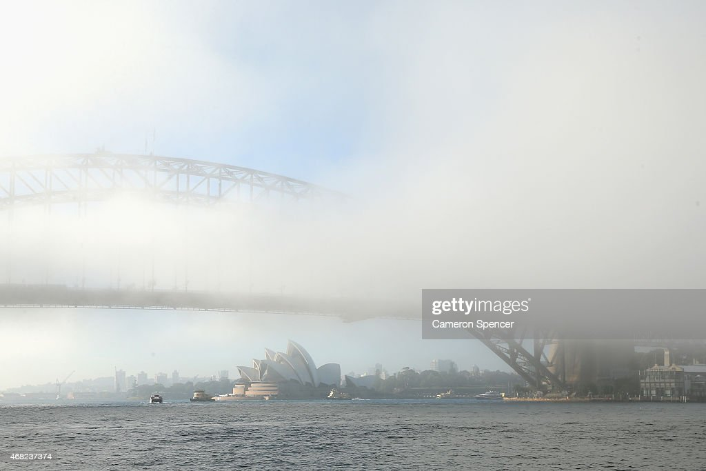 Fog blankets the Sydney Harbour Bridge and harbour as commuters head to work on April 1, 2015 in Sydney, Australia.