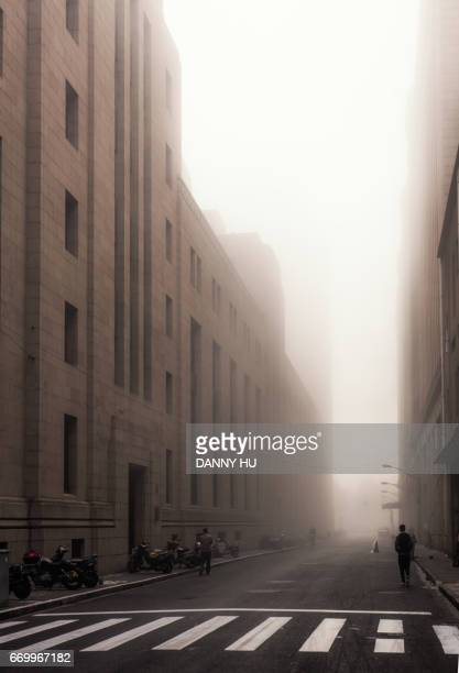 fog covering street in the bund,Shanghai