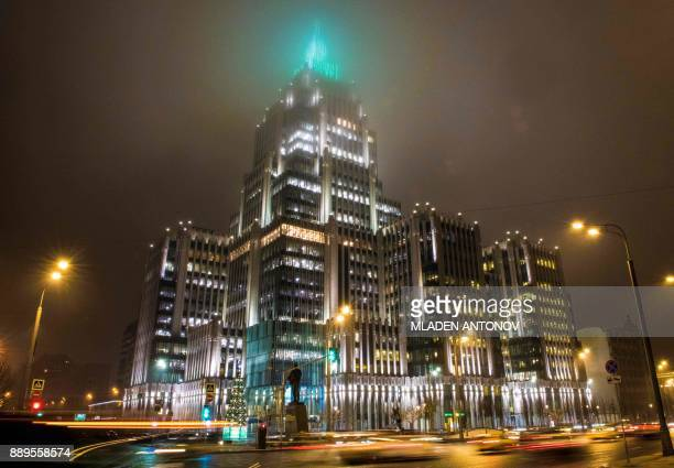 TOPSHOT Fog covers the top floors of an office building hosting some of the offices of stateowned Russian banking and financial services company...