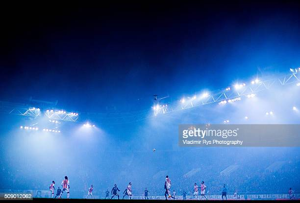 Fog from lighting flares stands over stadium during the Superleague Greece match between Olympiacos Piraeus and PAOK at Karaiskaki stadium on...