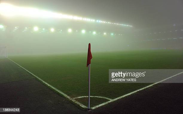 Fog gathers in the stadium prior to the English Premier league football match between Liverpool and Tottenham Hotspur at Anfield in Liverpool...