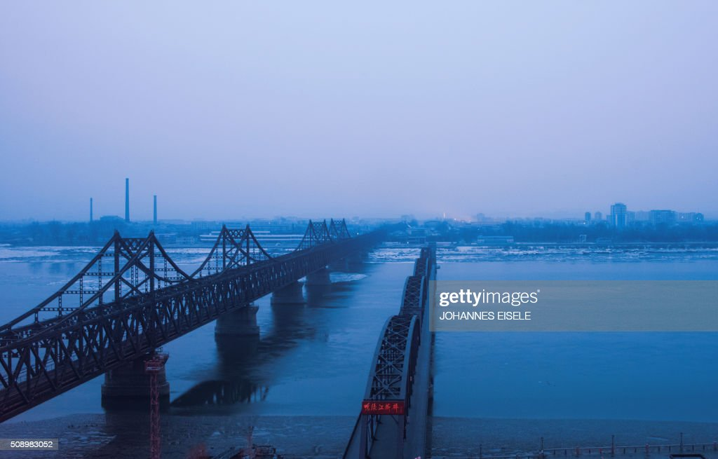 Fog is seen on the banks of the Yalu River in the Chinese border town of Dandong, opposite to the North Korean town of Sinuiju, on February 8, 2016. The UN Security Council strongly condemned North Korea's rocket launch on February 7 and agreed to move quickly to impose new sanctions that will punish Pyongyang for 'these dangerous and serious violations.' With backing from China, Pyongyang's ally, the council again called for 'significant measures' during an emergency meeting held after North Korea said it had put a satellite into orbit with a rocket launch. AFP PHOTO / JOHANNES EISELE / AFP / JOHANNES EISELE