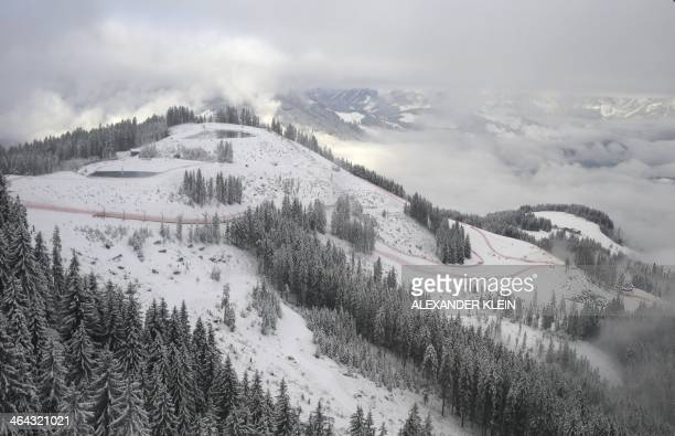 Fog is seen on the Hahnenkamm downhill ski slope ahead of the the FIS World Cup Men downhill in Kitzbuhel on January 22 2014 Today's men's downhill...