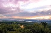 Fog lifts from the Kittany Mountains at sunset at High Point State Park, the top of NJ, in mid summer