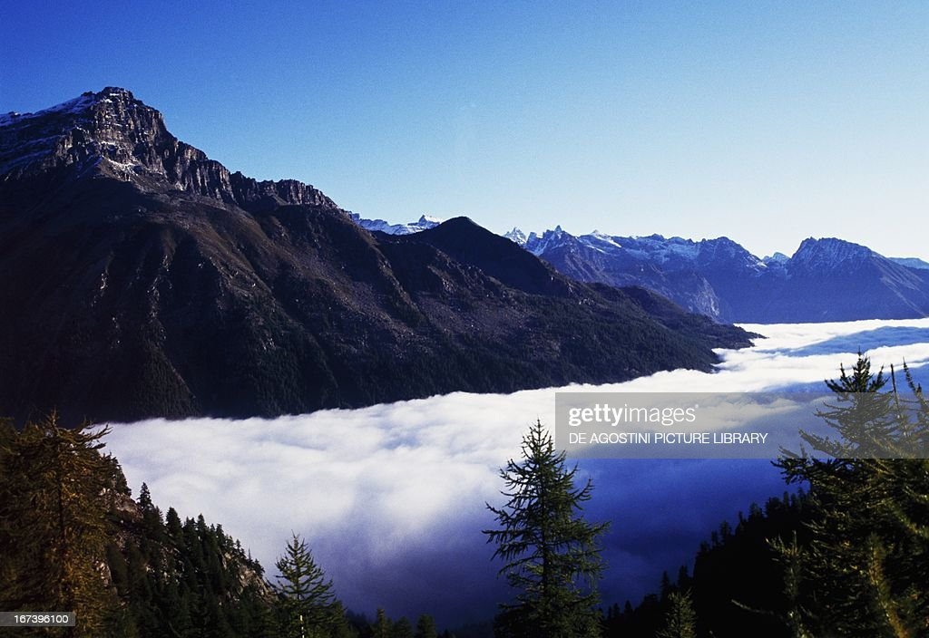 Fog on the valley of Ceresole Reale Orco valley province of Turin Piedmont region Italy